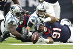 Houston Texans defensive end Carlos Watkins (91) reaches for the ball after Carolina Panthers quarterback Kyle Allen (7) fumbled during the first half of an NFL football game Sunday, Sept. 29, 2019, in Houston. (AP Photo/Michael Wyke)