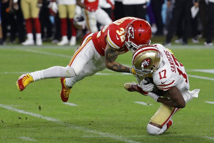 Kansas City Chiefs' Tyrann Mathieu (32) tackles San Francisco 49ers' Emmanuel Sanders (17) during the second half of the NFL Super Bowl 54 football game Sunday, Feb. 2, 2020, in Miami Gardens, Fla. (AP Photo/Seth Wenig)