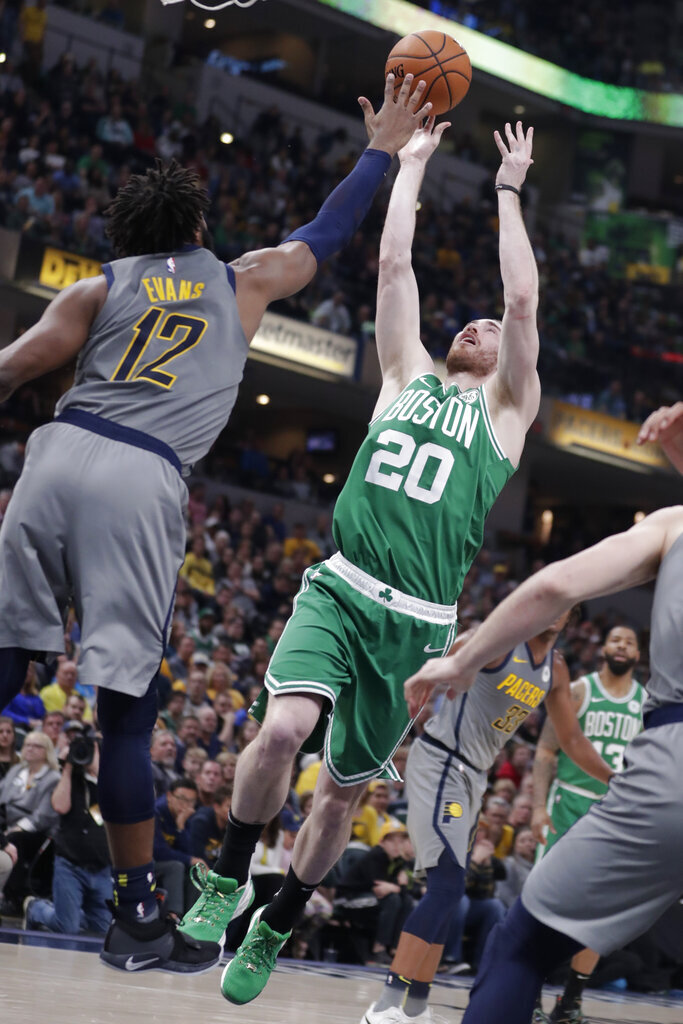 Boston Celtics forward Gordon Hayward (20) shoots over Indiana Pacers guard Tyreke Evans (12) during the second half of an NBA basketball game in Indianapolis, Friday, April 5, 2019. (AP Photo/Michael Conroy)
