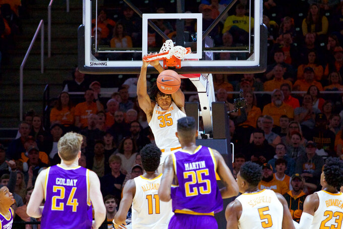 Tennessee forward Yves Pons (35) dunks the ball against Tennessee Tech in the first half of an NCAA college basketball game Saturday, Dec. 29, 2018, in Knoxville, Tenn. (AP Photo/Shawn Millsaps)
