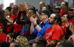 Union members applaud Democratic presidential candidate and former Vice President Joe Biden during town hall meeting at the Culinary Union, Local 226, headquarters in Las Vegas Wednesday, Dec. 11, 2019. (Steve Marcus/Las Vegas Sun via AP)