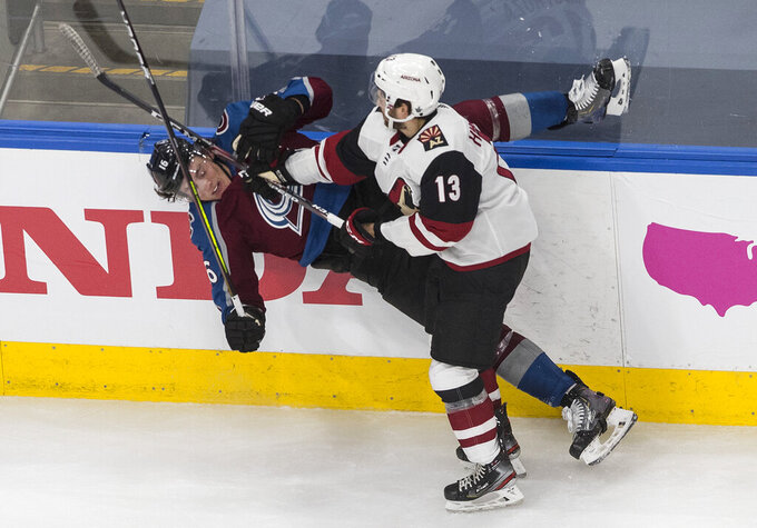 Colorado Avalanche's Nikita Zadorov (16) is checked by Arizona Coyotes' Vinnie Hinostroza (13) during the third period in Game 5 of an NHL hockey first-round playoff series in Edmonton, Alberta, Wednesday, Aug. 19, 2020. (Jason Franson/The Canadian Press via AP)