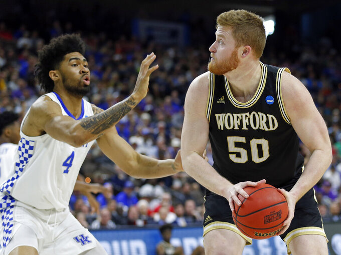 Wofford's Matthew Pegram (50) looks for a shot against Kentucky's Nick Richards (4) during the first half of a second-round game in the NCAA men's college basketball tournament in Jacksonville, Fla., Saturday, March 23, 2019. (AP Photo/Stephen B. Morton)