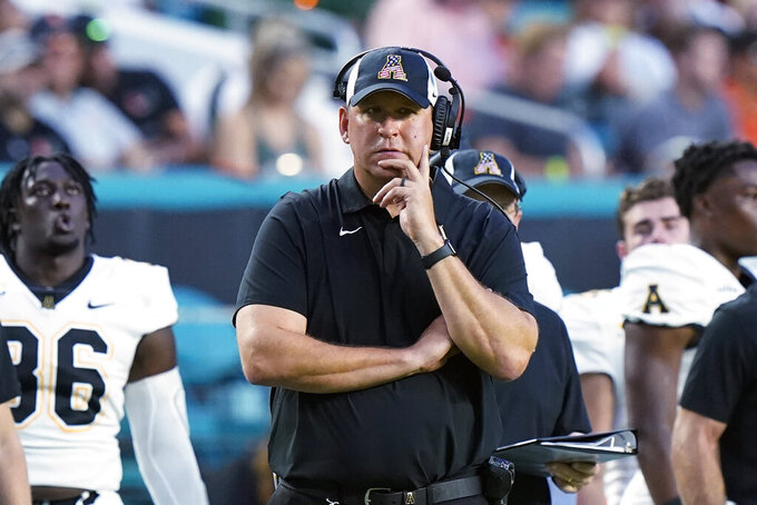 Appalachian State head coach Shawn Clark watches during the first half of an NCAA college football game against Miami, Saturday, Sept. 11, 2021, in Miami Gardens, Fla. (AP Photo/Wilfredo Lee)