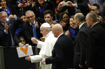Pope Francis leaves at the end of his weekly general audience in the Paul VI Hall at the Vatican, Wednesday, Feb. 20, 2019. (AP Photo/Alessandra Tarantino)