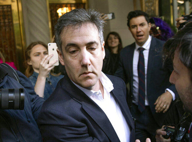 FILE - In this May 6, 2019, file photo, Michael Cohen, former attorney to President Donald Trump, leaves his apartment building before beginning his prison term in New York. President Trump's former lawyer and longtime fixer Cohen will be released from federal prison to serve the remainder of his sentence in home confinement amid the coronavirus pandemic, a person familiar with the matter told The Associated Press. (AP Photo/Kevin Hagen, File)