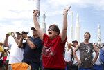 FILE - In this July, 8, 2011 file photo, Vanessa Fabrega, of Austin, Texas, cheers as she and others watch the launch of space shuttle Atlantis from the Kennedy Space Center Visitor Complex in Cape Canaveral, Fla. Atlantis was the 135th and final shuttle launch for the U.S. (AP Photo/Julie Fletcher)