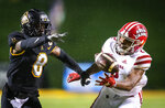 Louisiana-Lafayette wide receiver Kyren Lacy (2) misses a reception under coverage from Appalachian State defensive back Shemar Jean-Charles (8) during an NCAA college football game Friday, Dec. 4, 2020, in Boone, N.C. (Andrew Dye/The Winston-Salem Journal via AP, Pool)