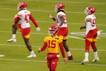 Kansas City Chiefs quarterback Patrick Mahomes (15) warms up with teammates during NFL football training camp, Saturday, Aug. 29, 2020, at Arrowhead Stadium in Kansas City, Mo. The Chiefs opened the stadium to 5,000 season ticket holders to watch practice as the team plans to open the regular season with a reduced capacity of approximately 22 percent of normal attendance. (AP Photo/Charlie Riedel)