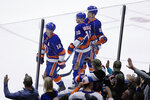 Fans cheer as New York Islanders' Josh Bailey (12), Derick Brassard (10) and Anders Lee skate past them after Brassard scored an empty-net goal during the third period of the team's NHL hockey game against the Tampa Bay Lightning on Friday, Nov. 1, 2019, in Uniondale, N.Y. The Islanders won 5-2. (AP Photo/Frank Franklin II)