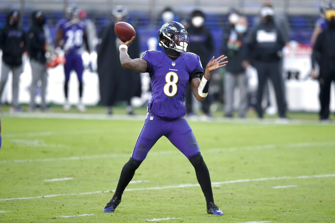 Baltimore Ravens quarterback Lamar Jackson throws a pass against the New York Giants during the first half of an NFL football game, Sunday, Dec. 27, 2020, in Baltimore. (AP Photo/Gail Burton)