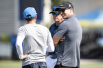 Former NFL quarterback Drew Brees, right, chats with Los Angeles Chargers owner Dean Spanos, center, and a Chargers personnel during an NFL football practice Wednesday, June 16, 2021, in Costa Mesa, Calif. (AP Photo/Kyusung Gong)