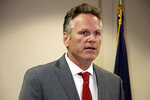 FILE - In this Aug. 13, 2019, file photo, Alaska Gov. Mike Dunleavy speaks at a news conference in Anchorage, Alaska. The group opposing an effort to recall Dunleavy plans to drop its court fight and instead gear up for a possible recall election. Stand Tall With Mike said Tuesday, Feb. 18, 2020, that it told its attorneys to withdraw its appeal before the Alaska Supreme Court. The group says recent court actions indicate that continuing to pursue the case in court would not be a productive use of resources. (AP Photo/Mark Thiessen, File)