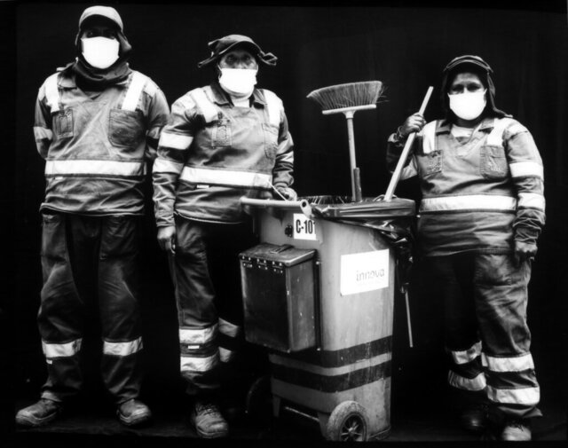 City street sweepers Angelo Paz Soldan, right, Teodosia Tito, center, and Biviana Torres Aderiano pose for a portrait in their uniforms and masks, during the new coronavirus a the Mesa Redonda market in Lima, Peru, Tuesday, Oct. 20, 2020.