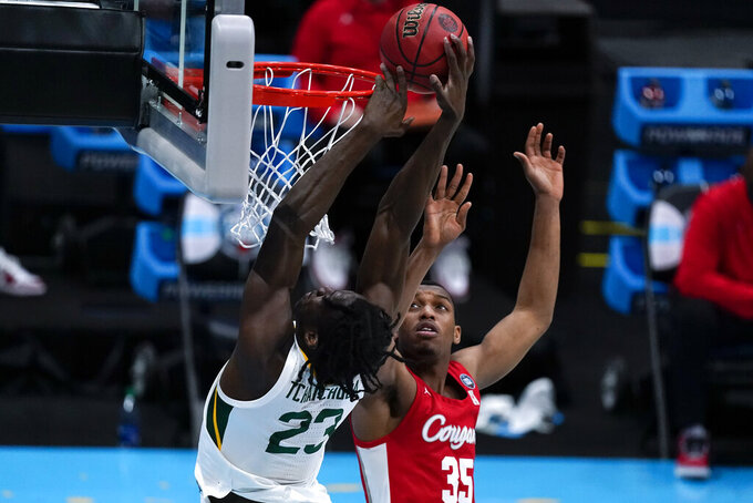 Baylor forward Jonathan Tchamwa Tchatchoua (23) drives to the basket over Houston forward Fabian White Jr. (35) during the first half of a men's Final Four NCAA college basketball tournament semifinal game, Saturday, April 3, 2021, at Lucas Oil Stadium in Indianapolis. (AP Photo/Michael Conroy)