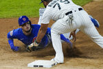 Chicago Cubs' Javier Baez, left, is tagged out by Chicago White Sox first baseman Jose Abreu during the seventh inning of a baseball game in Chicago, Friday, Sept. 25, 2020. (AP Photo/Nam Y. Huh)