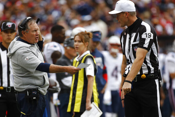 New England Patriots head coach Bill Belichick speaks with umpire Clay Martin (19) during the first half of an NFL football game against the Washington Redskins, Sunday, Oct. 6, 2019, in Washington. (AP Photo/Patrick Semansky)