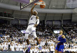 TCU forward JD Miller (15) dunks the ball after getting past Kansas guard Quentin Grimes (5) in the second half of an NCAA college basketball game in Fort Worth, Texas, Monday, Feb. 11, 2019. (AP Photo/Tony Gutierrez)