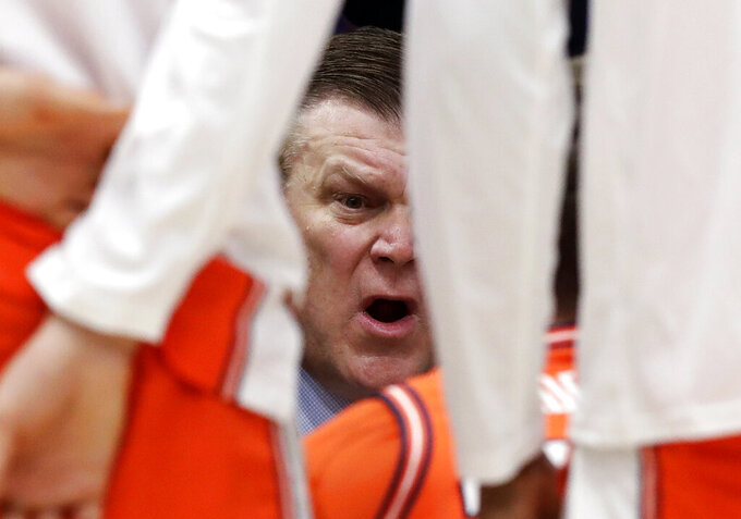 Illinois head coach Brad Underwood talks to his team during the first half of an NCAA college basketball game in the first round of the Big Ten Conference tournament against Northwestern in Chicago, Wednesday, March 13, 2019. (AP Photo/Nam Y. Huh)