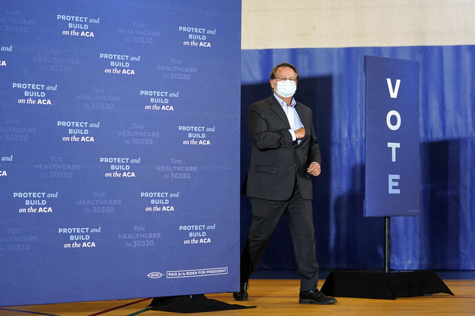 Sen. Gary Peters, D-Mich., arrives to speak during an event with Democratic presidential candidate former Vice President Joe Biden at Beech Woods Recreation Center, in Southfield, Mich., Friday, Oct. 16, 2020. (AP Photo/Carolyn Kaster)