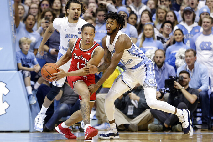 North Carolina guard Cole Anthony, left, and guard Leaky Black guard Ohio State guard CJ Walker (13) during the first half of an NCAA college basketball game in Chapel Hill, N.C., Wednesday, Dec. 4, 2019. (AP Photo/Gerry Broome)