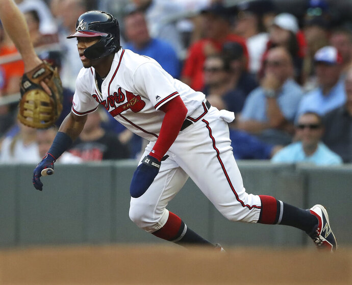 Atlanta Braves' Ronald Acuna Jr. leads off first base during the first inning of the team's baseball game against the New York Mets on Tuesday, Aug. 13, 2019, in Atlanta. (Curtis Compton/Atlanta Journal-Constitution via AP)
