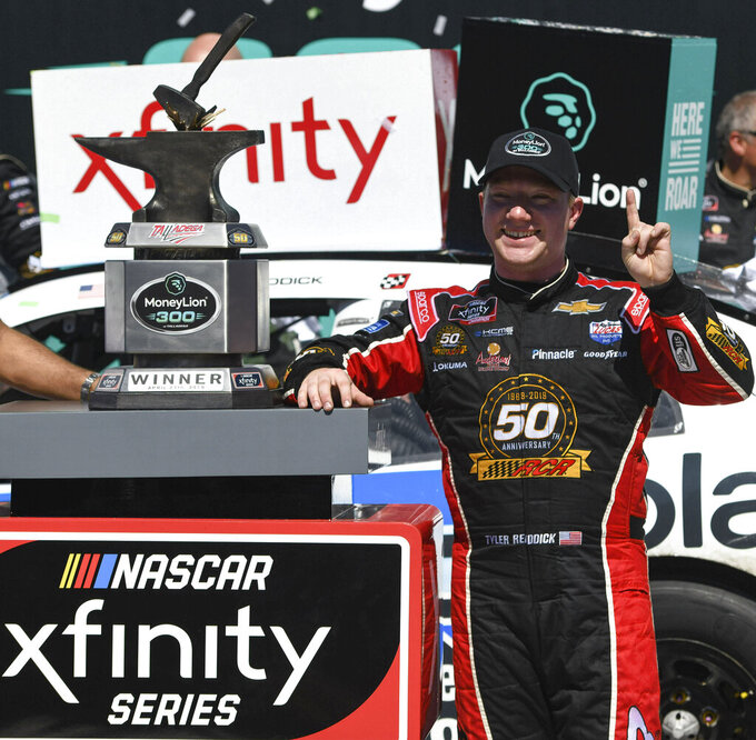 CORRECTS TO REDDICK NOT REDDCIK - Tyler Reddick celebrates in Victory Lane after winning a NASCAR Xfinity Series auto race at Talladega Superspeedway in Talladega, Ala., Saturday, April 27, 2019. (AP Photo/Julie Bennett)