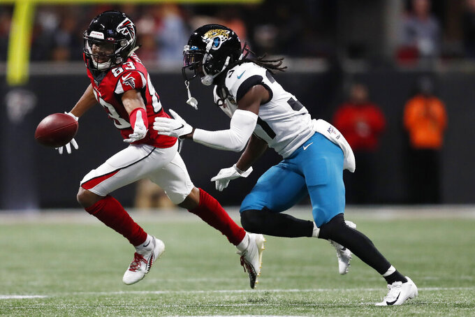 Atlanta Falcons wide receiver Russell Gage (83) misses the catch against Jacksonville Jaguars cornerback Tre Herndon (37) during the first half of an NFL football game, Sunday, Dec. 22, 2019, in Atlanta. (AP Photo/John Bazemore)