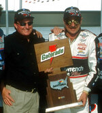 FILE - In this Feb. 1999, file photom NASCAR driver Dale Earnhardt, right, and team owner Richard Childress, pose in Victory Lane after Earnhardt won a qualifying auto race for the Daytona 500 at Daytona International Speedway in Daytona Beach, Fla. Childress, now 75, often wonders what NASCAR would look like had Earnhardt survived. Childress was far more than Earnhardt's car owner. The two were hunting and fishing buddies, business associates and close friends.  (AP Photo/Harold Hinson, File)