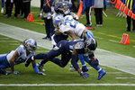 Tennessee Titans running back Derrick Henry scores against the Detroit Lions during the first half of an NFL football game Sunday, Dec. 20, 2020, in Nashville, N.C. (AP Photo/Ben Margot)