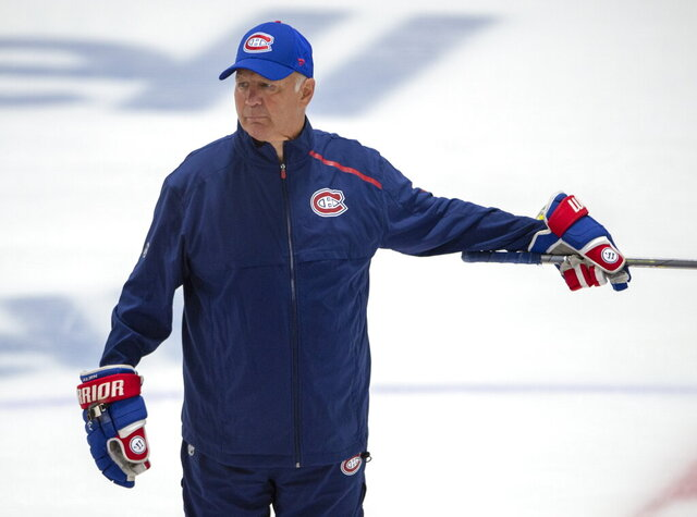FILE - Montreal Canadiens head coach Claude Julien gives instructions during NHL hockey practice in Brossard, Quebec, Tuesday, July 14, 2020. Canadiens general manager Marc Bergevin says coach Claude Julien was experiencing chest pains Wednesday, Aug. 12, 2020 and was taken by ambulance to a Toronto hospital. Bergevin confirmed it was not COVID-19 related. The 60-year-old coach is not expected to be back behind the bench for the rest of the team's first-round series against Philadelphia. Associate coach Kirk Muller will take over Julien's role in an interim basis. (Ryan Remiorz/The Canadian Press via AP)