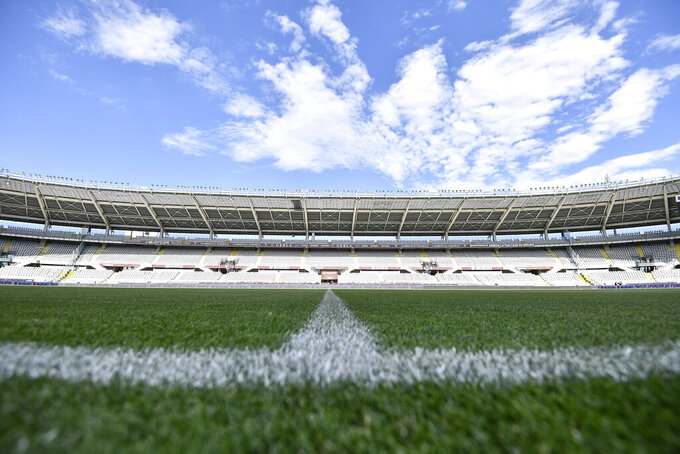 The stands are empty ahead of the Serie A soccer match between Torino and Parma, at the Olympic Stadium in Turin, Italy, Saturday, June 20, 2020. Serie A restarts Saturday with matches being played without spectators because of the coronavirus lockdown. (Fabio Ferrari/LaPresse via AP)