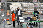 Maricopa County ballots cast in the 2020 general election are being examined and recounted by contractors working for Florida-based company, Cyber Ninjas, who was hired by the Arizona State Senate at Veterans Memorial Coliseum in Phoenix, Thursday, April 29, 2021. (Rob Schumacher/The Arizona Republic via AP, Pool)