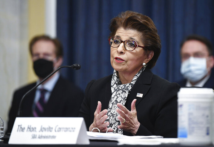 FILE - In this June 10, 2020 file photo, Jovita Carranza, Administrator of the Small Business Administration, testifies during a Senate Small Business and Entrepreneurship hearing to examine implementation of Title I of the CARES Act, on Capitol Hill in Washington. The Treasury Department said it is releasing on Monday, July 6 the names of more than 700,000 companies that received funds from the government's small business lending program, a massive effort intended to support the economy as states shut down in April to contain the viral outbreak.  (Kevin Dietsch/Pool via AP, File)