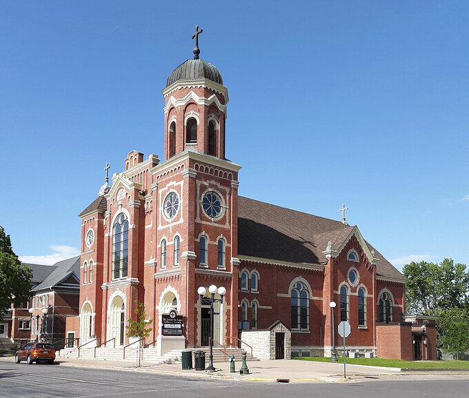 This June 2, 2021 photo shows St. James the Less parish in La Crosse, Wis. The Rev. James Altman who heads the parish, announced during a homily on May 23,  that Diocese of La Crosse Bishop Patrick Callahan had asked for his resignation. (Marilyn J. Richmond via AP)