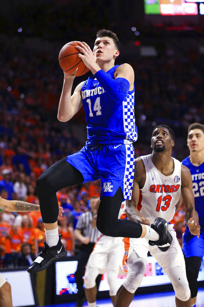 Kentucky guard Tyler Herro makes a shot past Florida center Kevarrius Hayes during the second half of an NCAA college basketball game Saturday, Feb. 2, 2019, in Gainesville, Fla. Kentucky defeated Florida 65-54. (AP Photo/Matt Stamey)