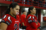 In this Nov. 8, 2019 photo, Jayton Pease, left, waits to get on the field alongside his brother Jashawn, before the All Nations Football Conference championship in Vermillion, S.D.  Jashawn and Jayton Pease shed tears as the Crow Creek Chieftains won the first All Nations Conference championship, and then remembered their older brother one of too many American Indians to die by suicide on a reservation with the highest suicide rate in South Dakota. (AP Photo/Stephen Groves)