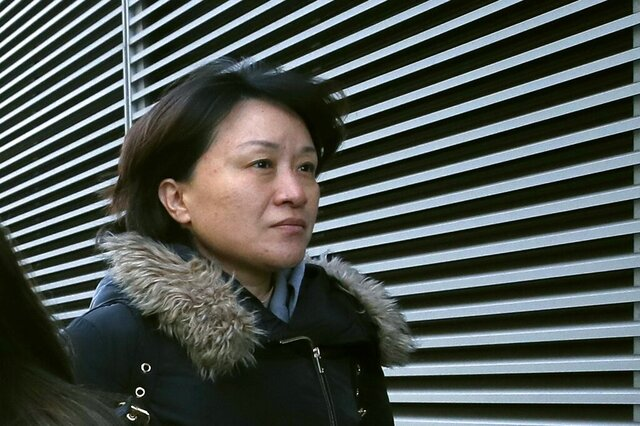 Xiaoning Sui, a Chinese national residing in British Columbia, Canada, leaves federal court, Friday, Feb. 21, 2020, in Boston, after pleading guilty to paying $400,000 to get her son into the University of California, Los Angeles, as a fake soccer recruit. (AP Photo/Elise Amendola)