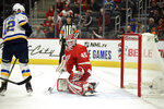 St. Louis Blues left wing Zach Sanford, left, watches his puck go in the net past Detroit Red Wings goaltender Jonathan Bernier in the first period of an NHL hockey game, Sunday, Oct. 27, 2019. (AP Photo/Jose Juarez)