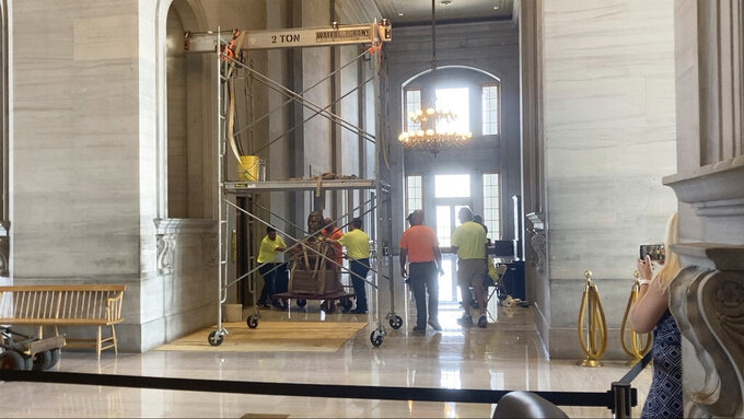 The Nathan Bedford Forrest bust is removed from inside of the Tennessee Capitol on Friday, July 23, 2021 in Nashville.   Tennessee's State Building Commission voted 5-2 to remove the bust of the Confederate general and early Ku Klux Klan leader on Thursday, the final hurdle in a months-long process.  (AP Photo/Kimberlee Kruesi)