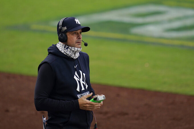New York Yankees manager Aaron Boone takes part in a TV interview during a pause in Game 4 of a baseball American League Division Series against the Tampa Bay Rays, Thursday, Oct. 8, 2020, in San Diego. (AP Photo/Gregory Bull)