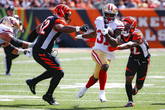 San Francisco 49ers running back Raheem Mostert (31) runs past Cincinnati Bengals middle linebacker Preston Brown (52) and cornerback William Jackson (22) for a touchdown during the first half an NFL football game, Sunday, Sept. 15, 2019, in Cincinnati. (AP Photo/Frank Victores)