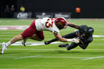 Iowa State linebacker Mike Rose (23) tackles UNLV running back Courtney Reese (26) during the second half of an NCAA college football game Saturday, Sept. 18, 2021, in Las Vegas. (AP Photo/John Locher)