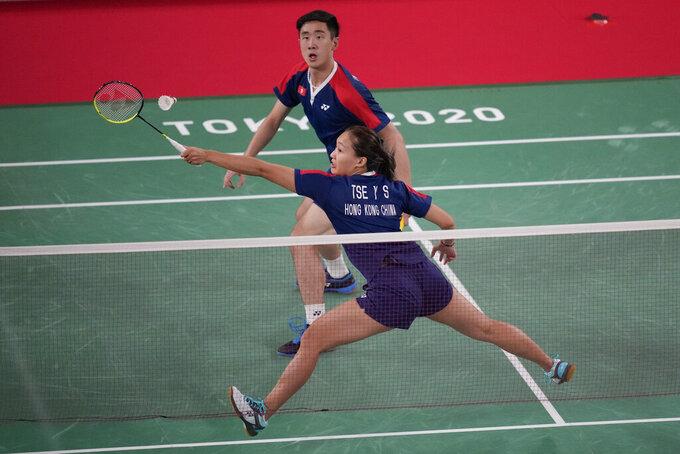 Hong Kong's Tang Chun Man and Tse Ying Suet polar against China's Zheng Si Wei and Huang Ya Qiong during their mixed doubles semifinal matchat the 2020 Summer Olympics, Thursday, July 29, 2021, in Tokyo, Japan. (AP Photo/Dita Alangkara)