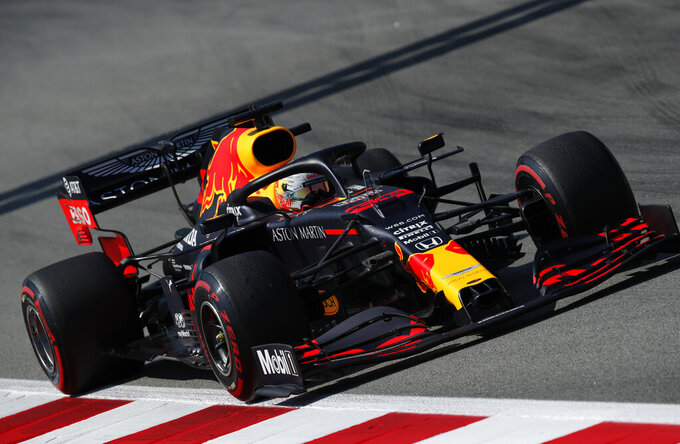 Red Bull driver Max Verstappen of the Netherlands steers his car during a practice session prior to the Formula One Grand Prix at the Barcelona Catalunya racetrack in Montmelo, Spain, Friday, Aug. 14, 2020. (Albert Gea, Pool via AP)