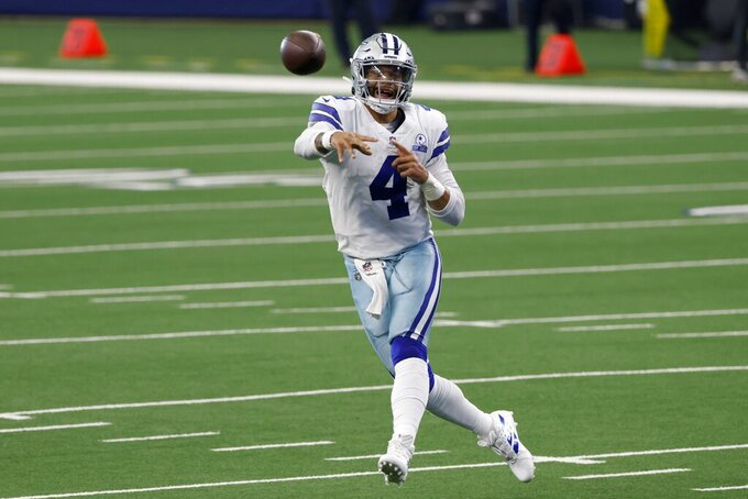Dallas Cowboys quarterback Dak Prescott (4) throws a pass in the first half of an NFL football game against the New York Giants in Arlington, Texas, Sunday, Oct. 11, 2020. (AP Photo/Ron Jenkins)