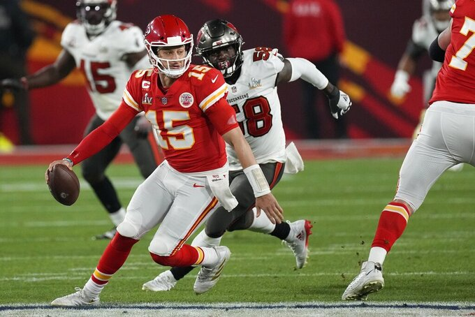 Kansas City Chiefs quarterback Patrick Mahomes looks to throw against the Tampa Bay Buccaneers during the second half of the NFL Super Bowl 55 football game Sunday, Feb. 7, 2021, in Tampa, Fla. (AP Photo/David J. Phillip)