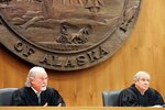 Alaska Supreme Court Justices Craig Stowers, left, and Daniel Winfree listen to arguments in a lawsuit that claims state policy on fossil fuels is harming the constitutional right of young Alaskans to a safe climate Wednesday, Oct. 9, 2019, in Anchorage, Alaska. Sixteen Alaska youths in 2017 sued the state, claiming that human-caused greenhouse gas emission leading to climate change is creating long-term, dangerous health effects. They lost in Superior Court, but appealed to Alaska's highest court. (AP Photo/Mark Thiessen)