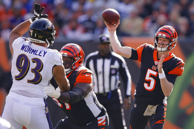 Cincinnati Bengals quarterback Ryan Finley (5) passes during the first half of NFL football game against the Baltimore Ravens, Sunday, Nov. 10, 2019, in Cincinnati. (AP Photo/Gary Landers)