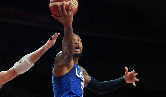 United States' Damian Lillard (6) drives to the basket during men's basketball quarterfinal game against Spain at the 2020 Summer Olympics, Tuesday, Aug. 3, 2021, in Saitama, Japan. (AP Photo/Eric Gay)